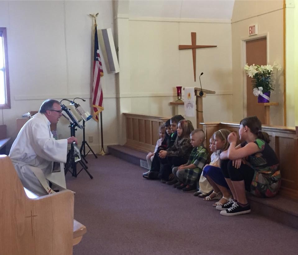 Pastor Jay & Children on Easter